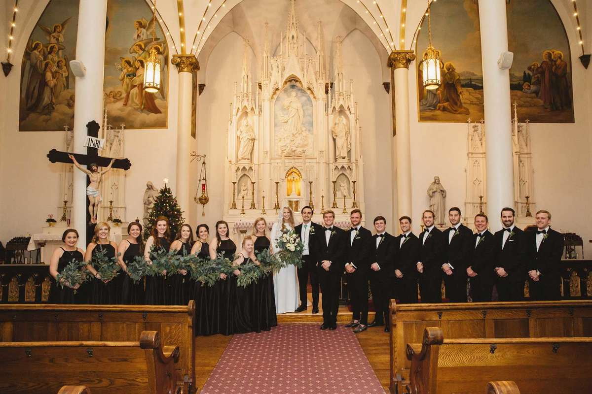 winter bridal party with black and greenery