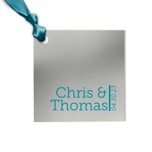 Our custom Metallic Sterling Silver Matte Rectangle Gift Tag with Satin Teal / Peacock Foil are a must-have for your next event—whatever the celebration!