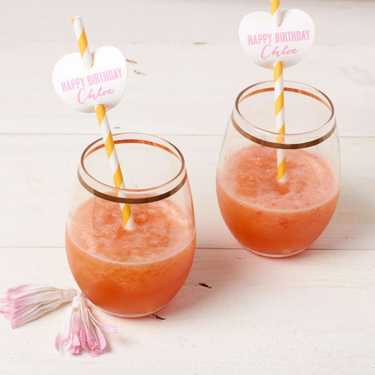 frost, frozen rose cocktail with personalized heart straw tags
