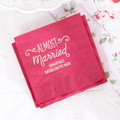 ForYourParty's chic Fuchsia Cocktail Napkin with Matte Pastel Pink Foil has a Almost Married 3 graphic and is good for use in Words, Bridal Shower themed parties and can be customized to complement every last detail of your party.