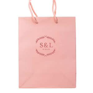 ForYourParty's personalized Ballet Pink Gift Bag with Shiny Rose Quartz Foil has a Branch Frame graphic and is good for use in Floral,  Wedding and Garden themed parties and can be personalized to match your party's exact theme and tempo.