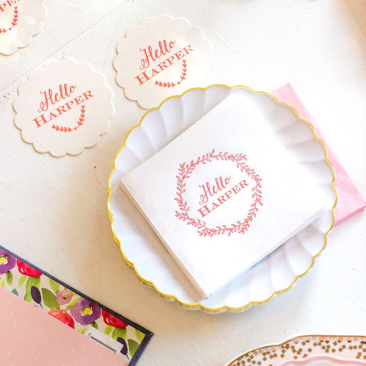 foil stamped pink baby napkins with a leaf wreath for a baby girl sip and see
