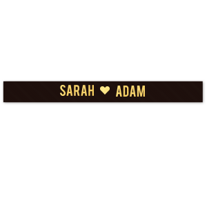 "Personalized Black 5/8"" Satin Ribbon with Shiny 18 Kt Gold Foil Color has a Solid Heart graphic and is good for use in Wedding themed parties and can be personalized to match your party's exact theme and tempo."
