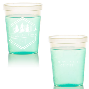 Dress up drinks with your theme! Pair your initials with the banner and trees in our Adventure Badge for a seamless detail in your forest or greenery themed wedding. Add your destination and date to the back for a personal touch. Fun in the moment, they will also make fetching personalized wedding favors.