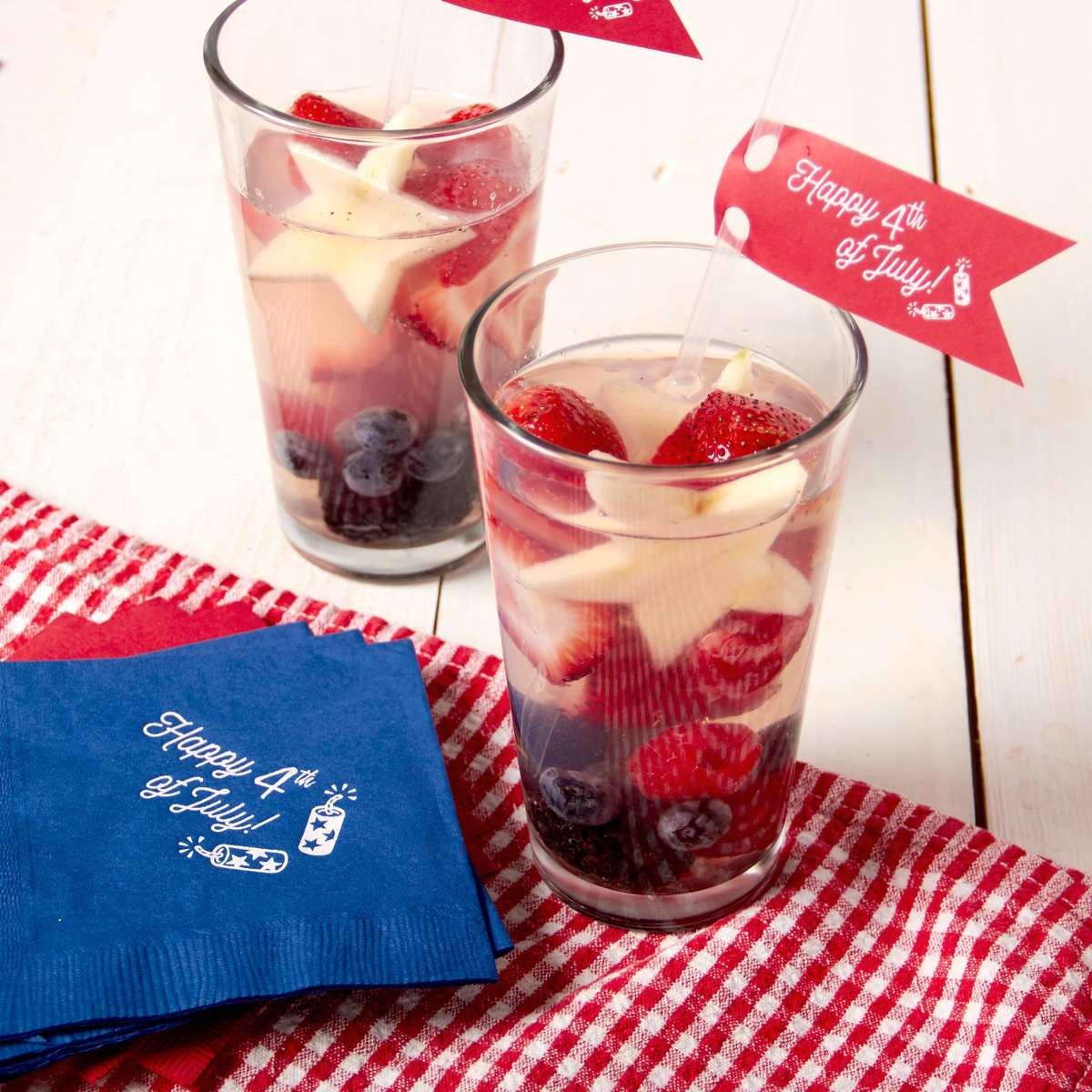 4th of July themed cocktails with personalized party napkins perfect for a picnic or bbq