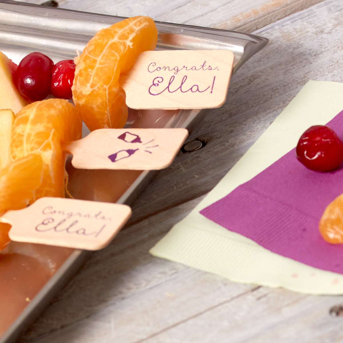 baby shower fruit kebobs with custom stir sticks