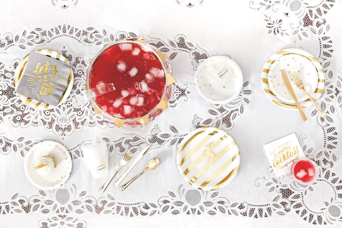 christmas party supplies with gold paper plates and cute party cups