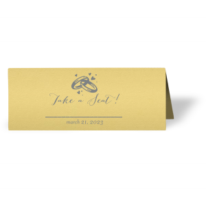 Customize place cards and impress guests with beautiful wedding details. This card leaves space for a name and table number, right under our classic Wedding Rings graphic and catchy calligraphy saying. Choose your theme colors and add your wedding date for a personal touch.