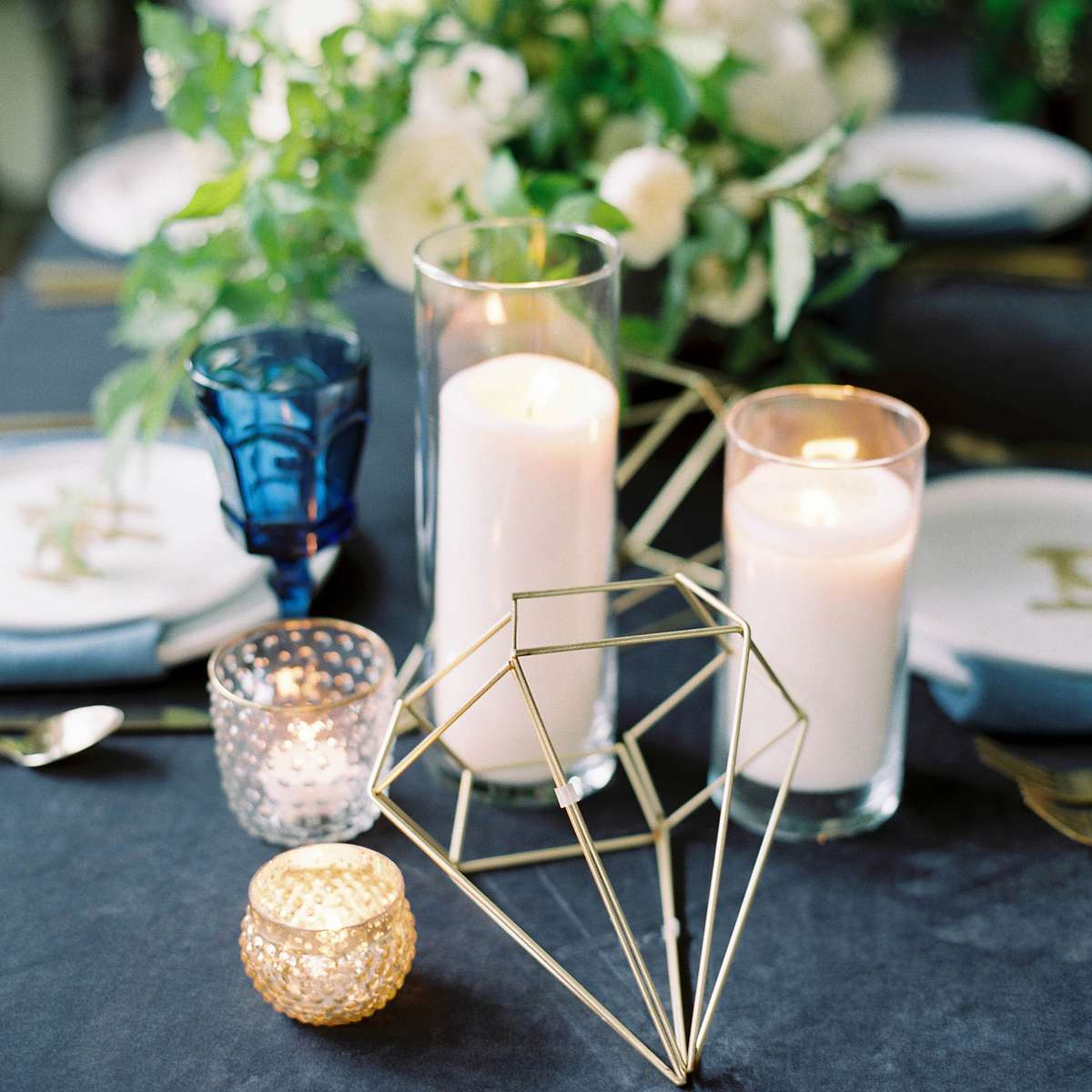 industrial glam party table decorations with wire diamonds, colored glasses and garland