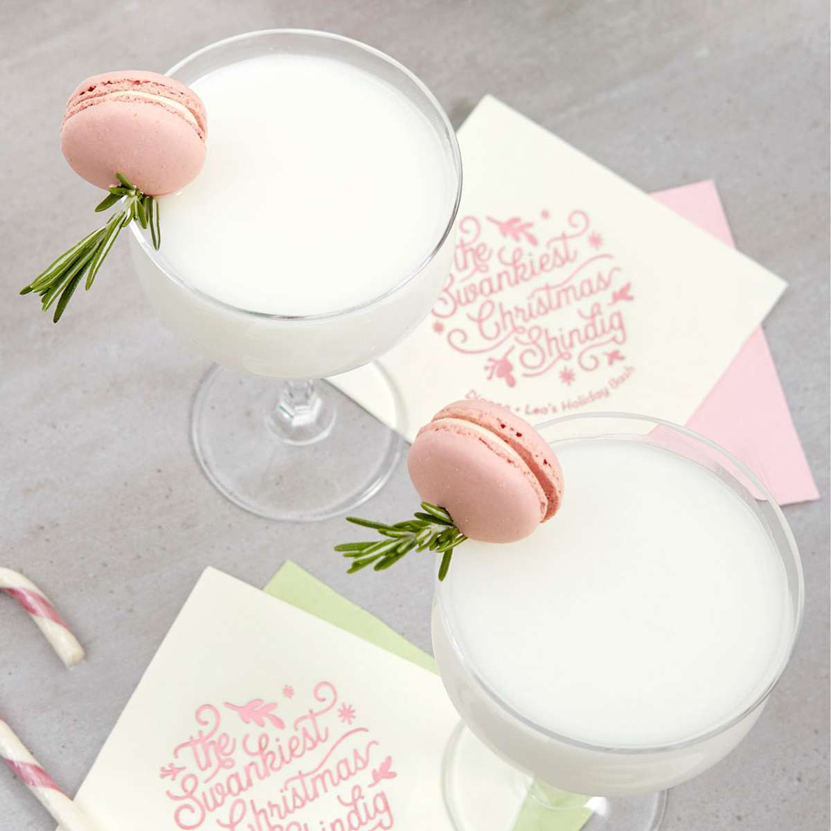 creamy rum cocktail recipe with rose syrup and a custom cocktail napkin