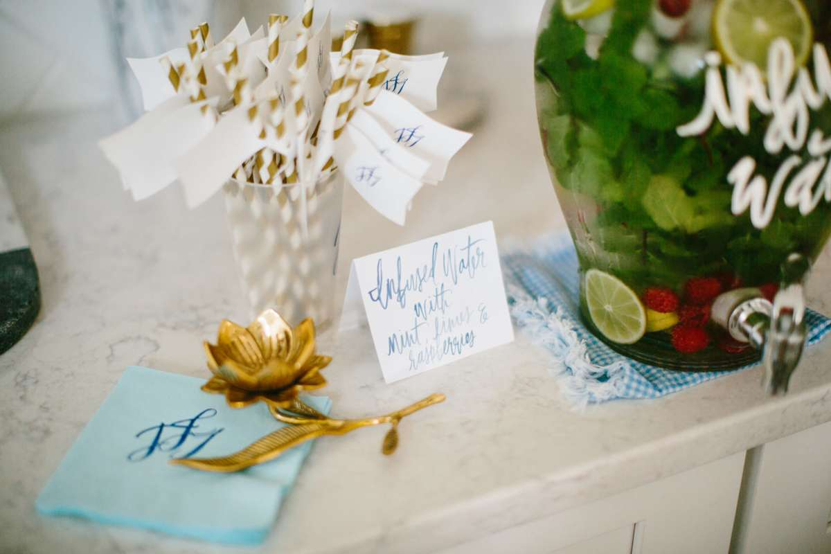 boy baby shower water station ideas with infused water and watercolor signs