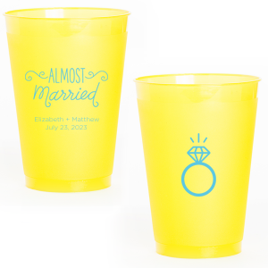 Our custom Yellow 12 oz Frost Flex Color Cup with Matte Turquoise Ink Cup Ink Colors has a Almost Married 3 graphic and a Diamond Ring graphic and is good for use in Engagement, Wedding, Bridal Shower themed parties and are a must-have for your next event—whatever the celebration!