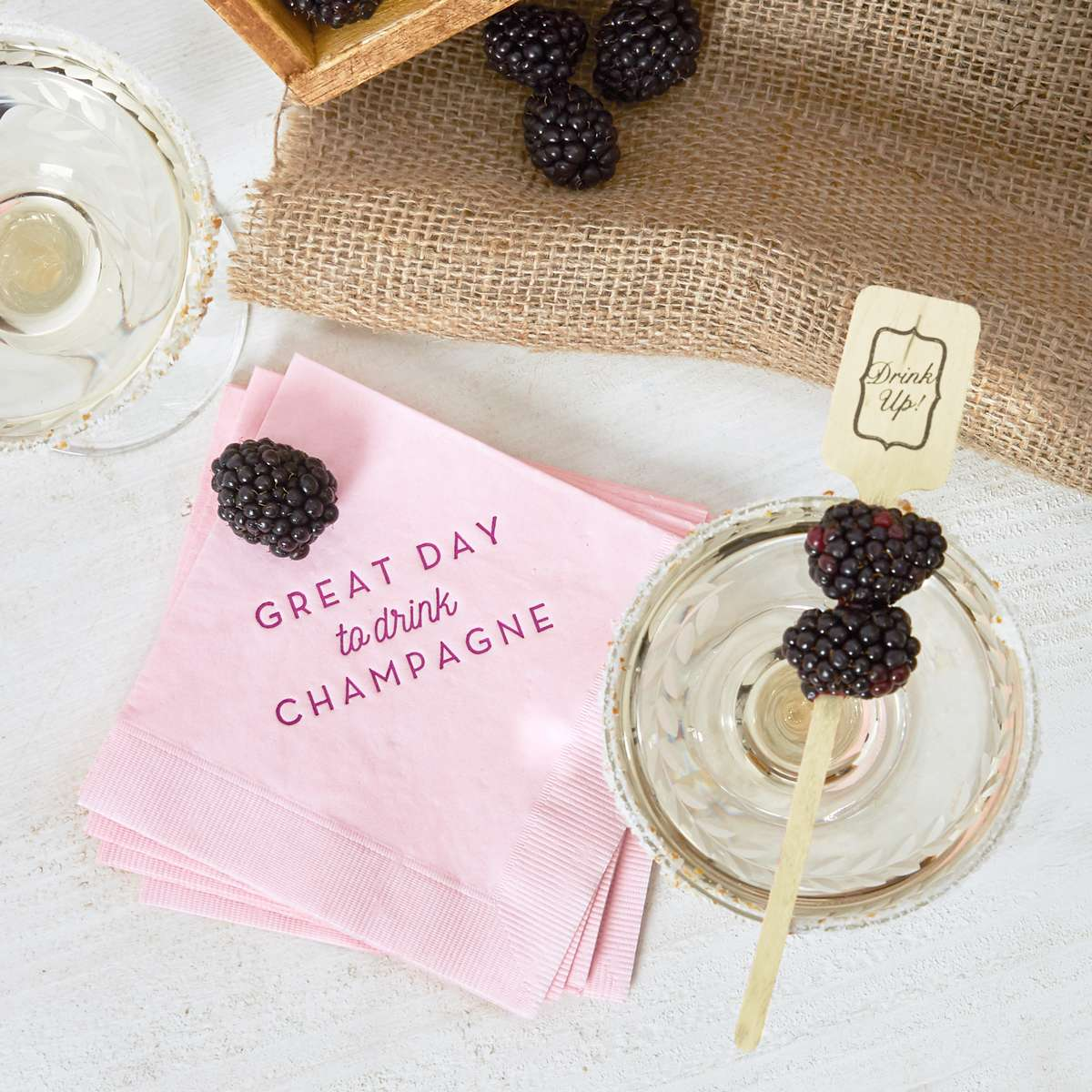 blackberry champagne with personalized cocktail napkins
