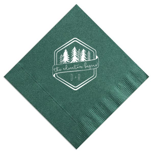 Add the perfect touch to your bar, dessert table or appetizers with this Adventure Begins personalized napkin. Pair your initials with the banner and trees in our Adventure Badge for a seamless detail in your forest or greenery themed wedding.