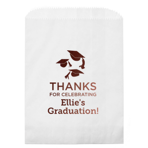 ForYourParty's elegant Kraft Brown Lunch Bag with Shiny Merlot Foil Color has a Caps Thrown graphic and is good for use in Graduation themed parties and will give your party the personalized touch every host desires.
