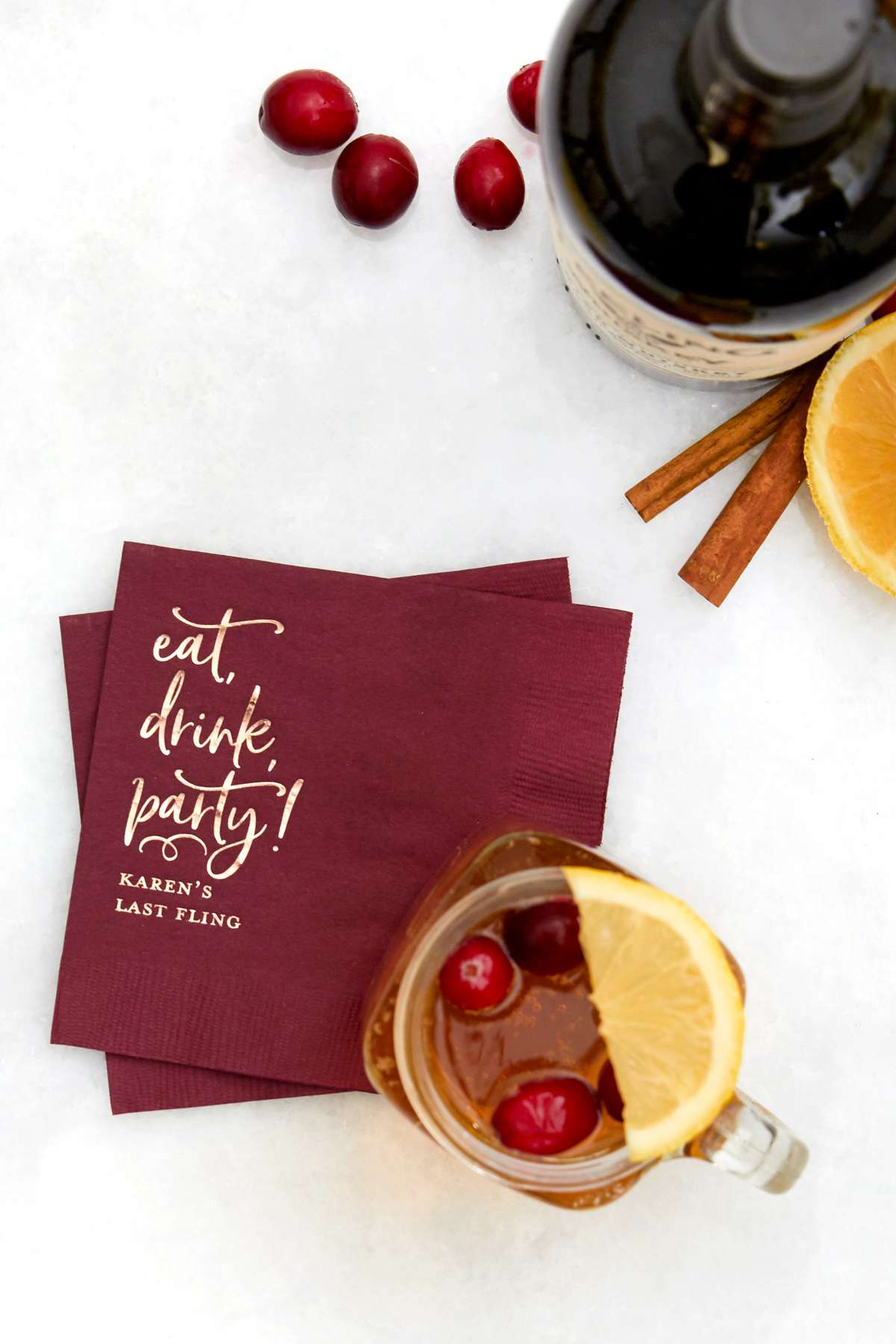 Holiday Whiskey Toddy cocktail recipe with personalized cocktail napkin