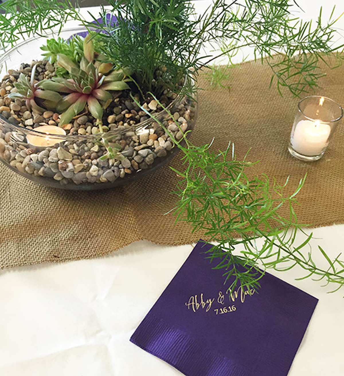 Succulent centerpieces with personalized cocktail napkin