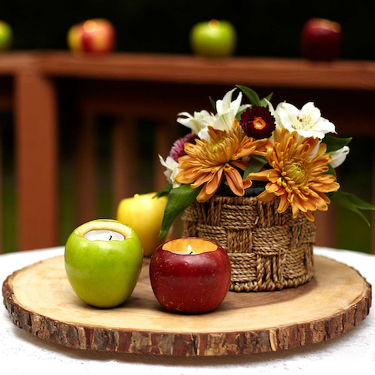 fall centerpiece with apples, flowers and diy votive candle holders