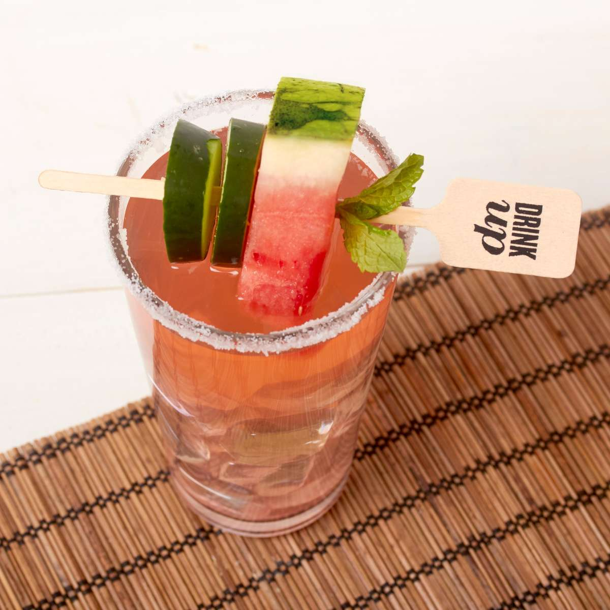 watermelon and cucumber cocktail with a custom drink stirrer