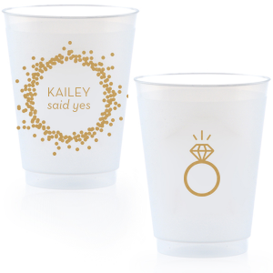 Our personalized Gold Ink 16 oz Frost Flex Cup with Gold Ink Screen Print has a Confetti Frame graphic and a Diamond Ring graphic and is good for use in Engagement and Wedding themed parties and are a must-have for your next event—whatever the celebration!