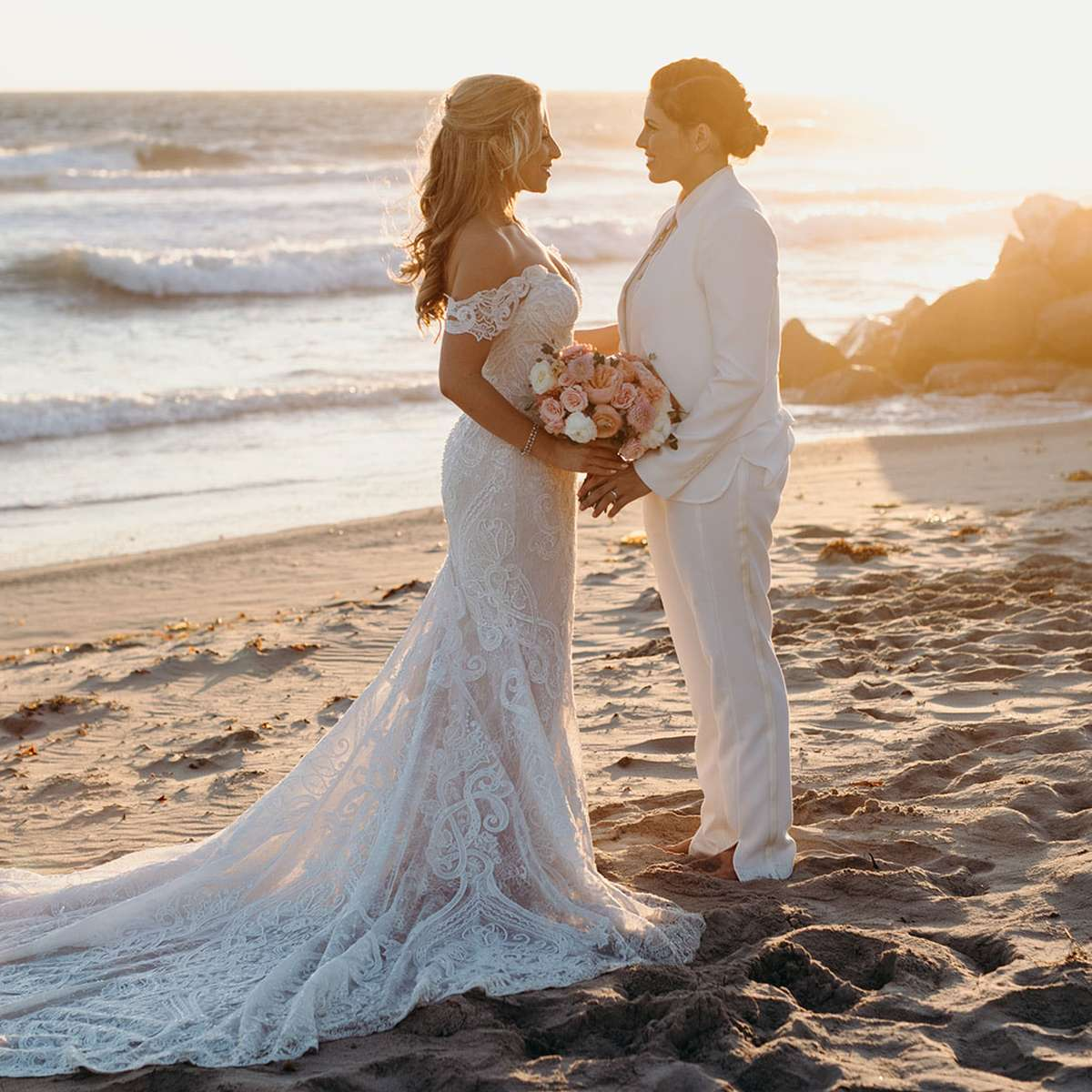 beach wedding sunset picture with two brides in Malibu