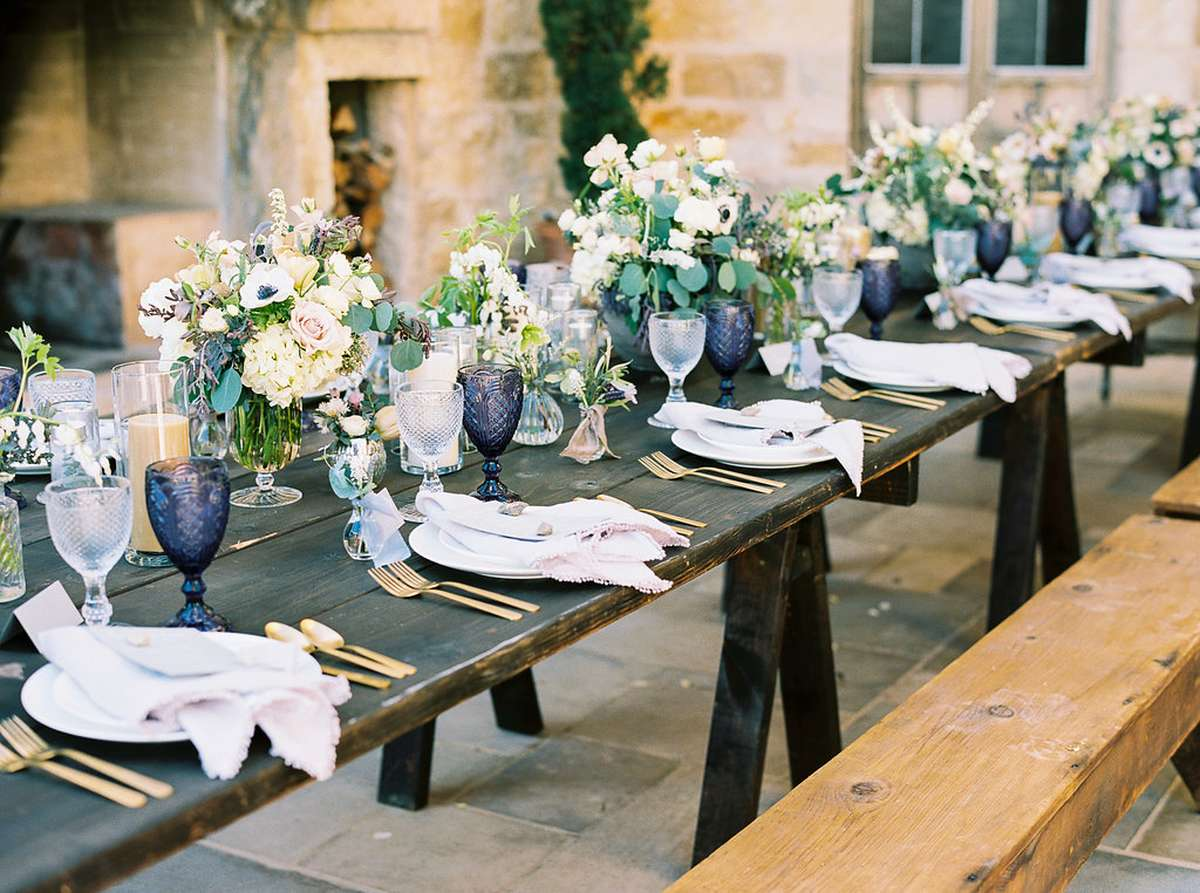 tuscan dinner party with color glasses, peony bouquets and purple napkins