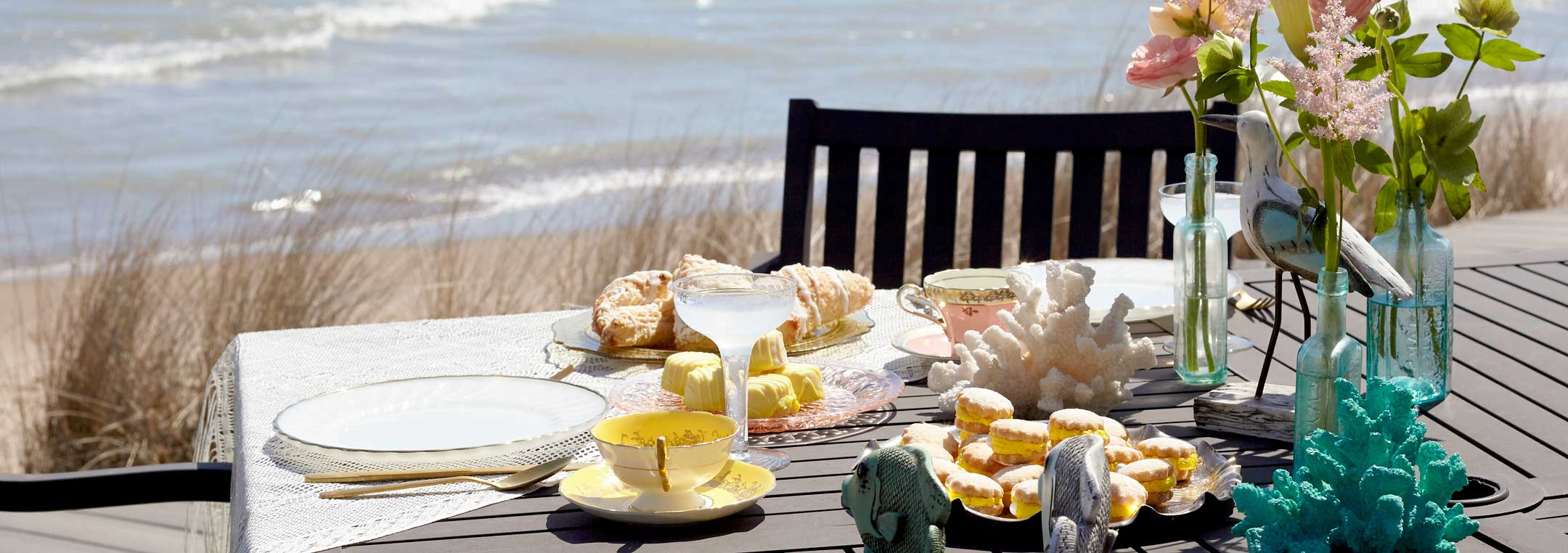 ideas for throwing a mermaid themed party like a beach setting and tea party tablescape