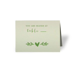 Escort your guests to their seats in style with a greenery themed place card. Our Heart Branch graphic will fit right in with all of your wedding decor. Stick with this Mint paper and Matte Moss foil or choose your own colors to create the perfect complement to your wedding tablescape.