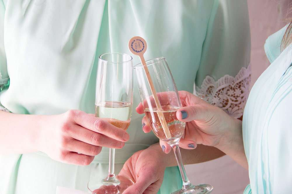 wedding champagne toast with custom cocktail stirrers