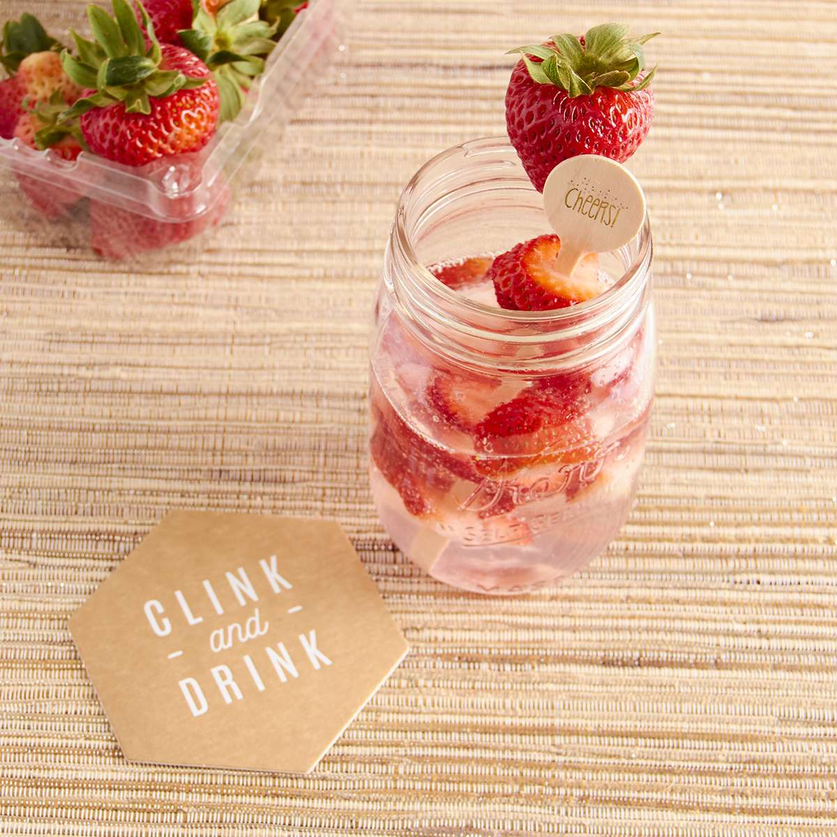 cocktails with rose water and custom coasters and drink stirrers
