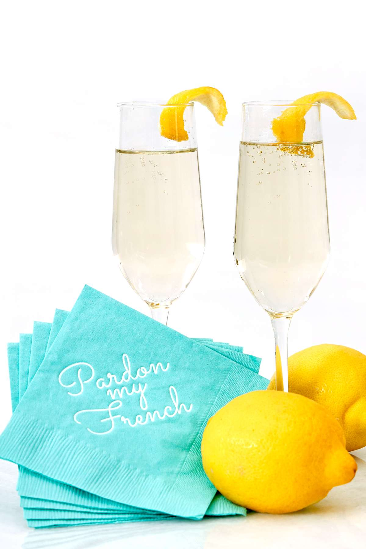 french 75 cocktail recipe with pardon my french cocktail napkin