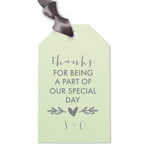 Say thank you with a wedding favor or treat tied with a custom gift tag. Choose your theme colors and add your initials as the perfect complement to our modern calligraphy script and Heart Branch graphic.