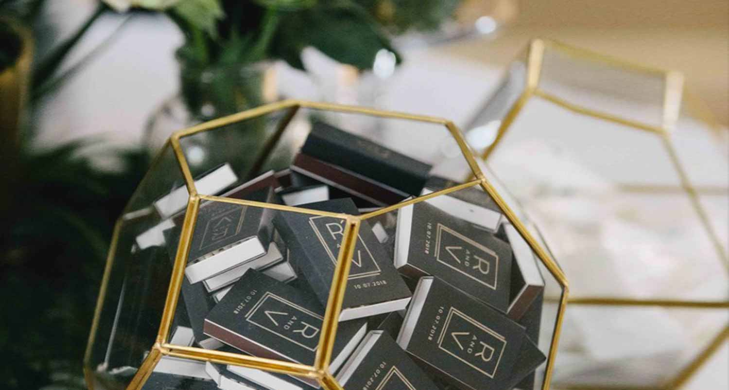 gold and glass bowl with black classic matchboxes with custom design in satin gold foil
