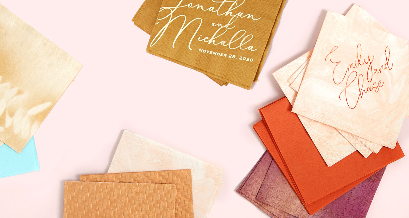 A collection of cocktail napkins and patterned cocktail napkins in fall colors