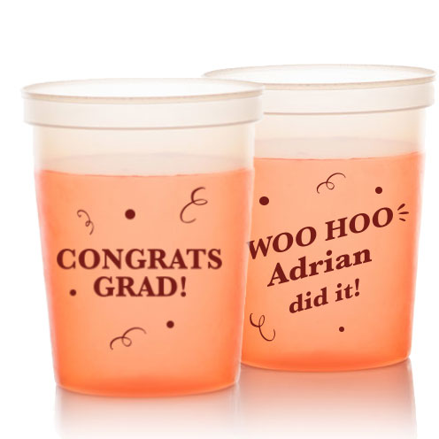 Color Changing stadium cup in orange with congrats grad confetti design