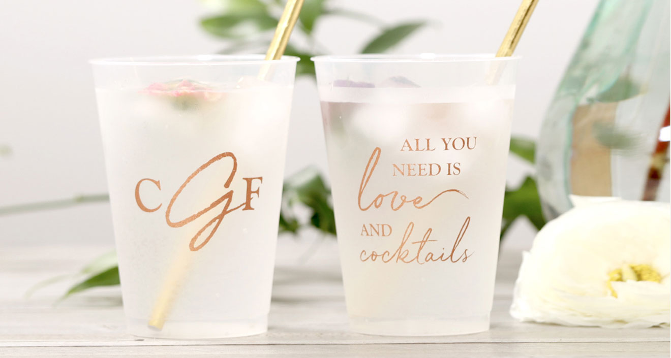 a collection of frost flex cups with a monogram and a all you need is love and a cocktail design in gold ink