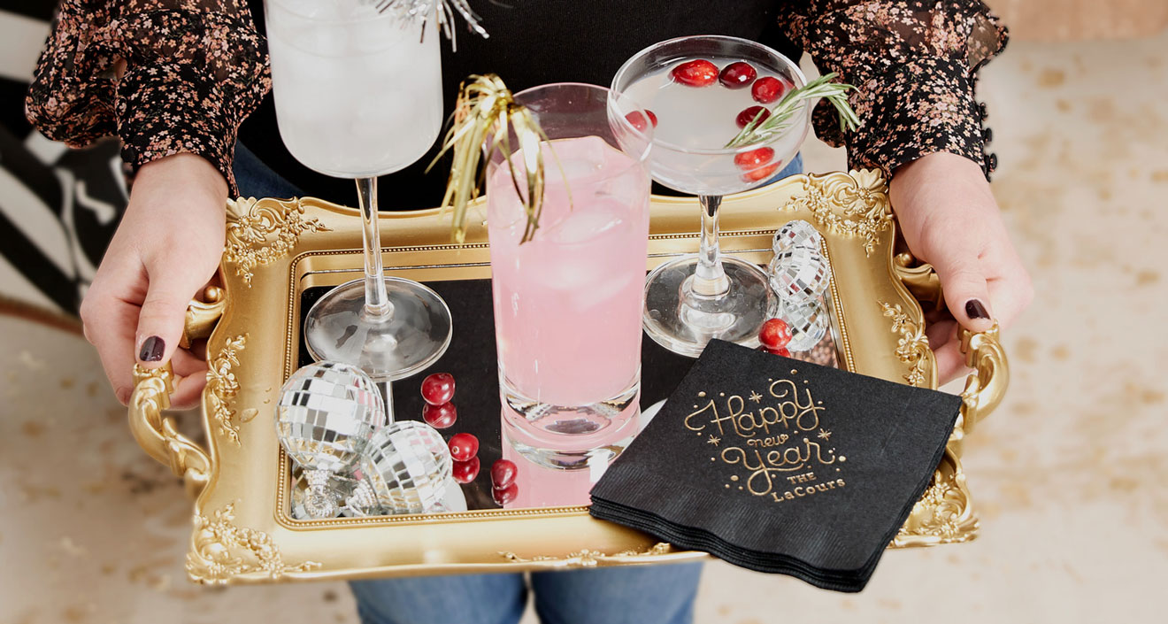 Black Cocktail Napkins with Shiny Gold Foil on Tray with cocktails