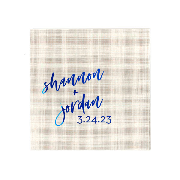 Script names and date foil stamped in shiny royal blue foil on a crosshatch stone cocktail napkin