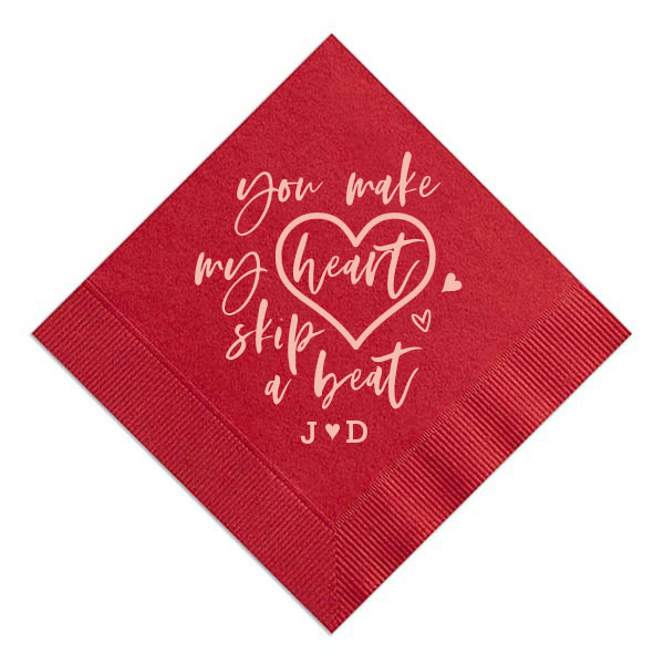 Lipstick Red cocktail napkin with the you make my heart skip a beat design in shiny rose gold foil