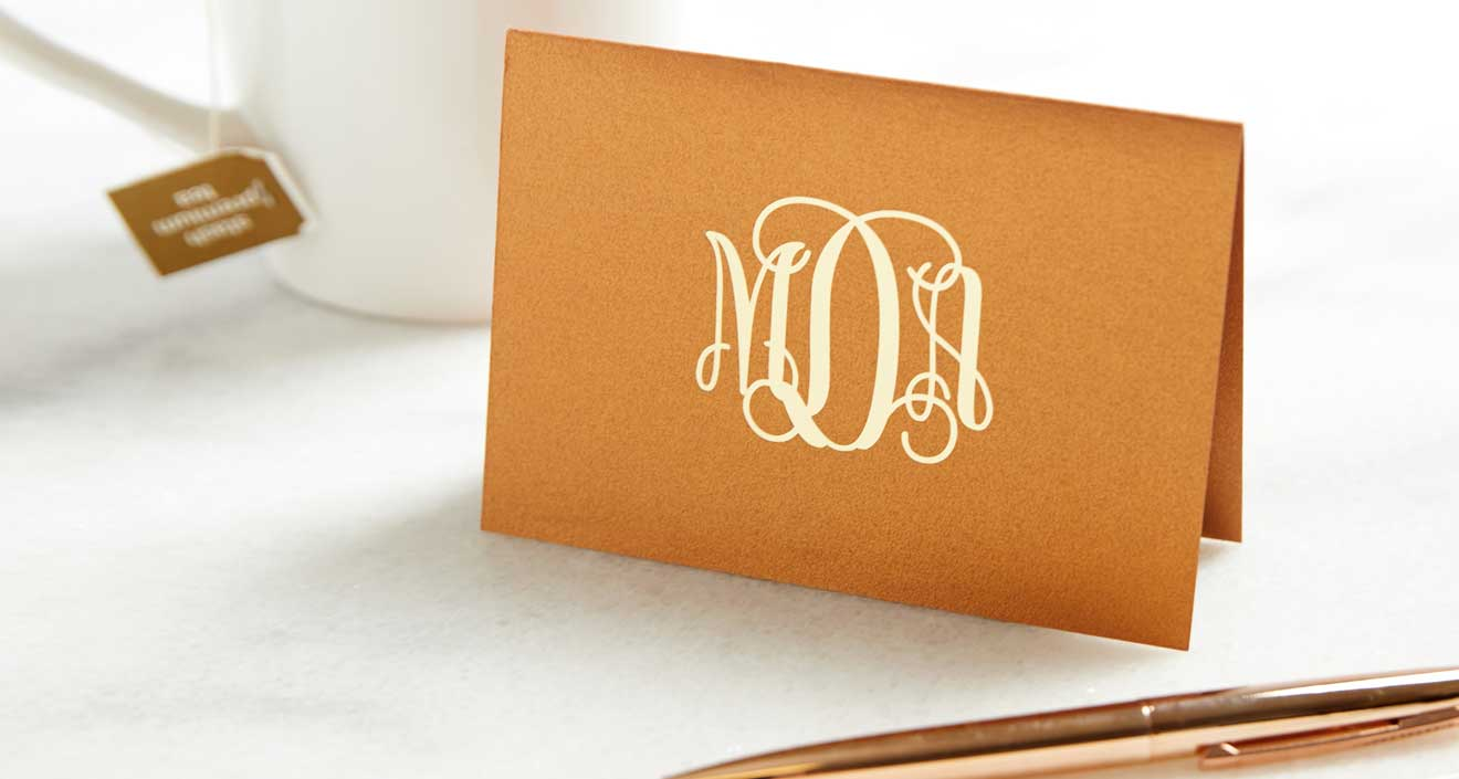 Copper Notecard with monogram design in ivory foil