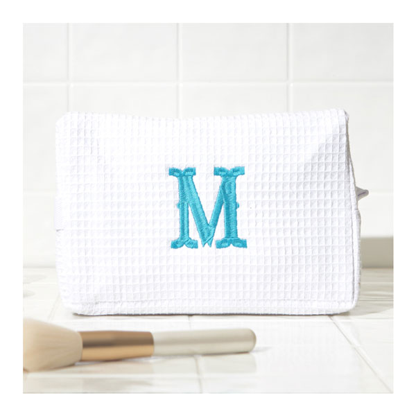 White woven cosmetic bag with turquoise embroidered initial M