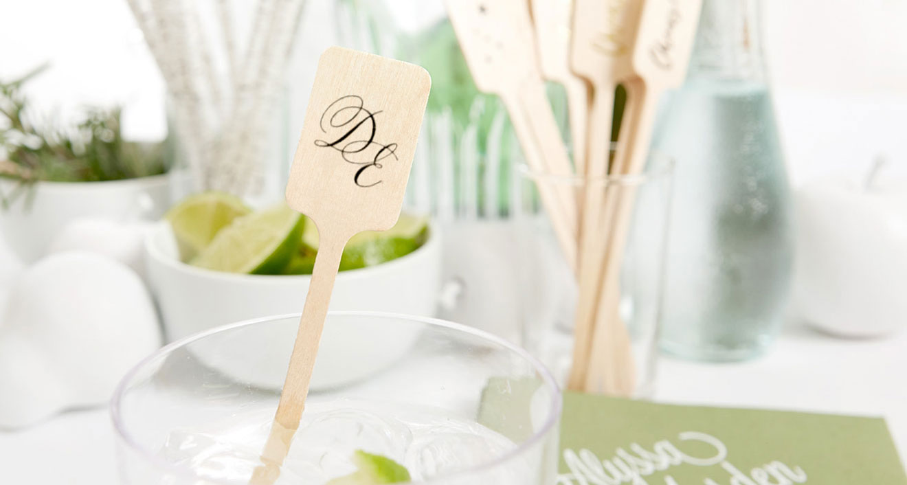 Wooden Rectangle stir stick with matte black foil stamped cursive couple's initials